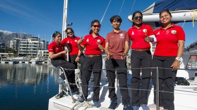 In this photo supplied by Networx PR, crew of the INSV Tarini vessel pose on deck for a photograph after their arrival in Cape Town Harbour, South Africa Friday, March 3, 2018.(AP Photo)