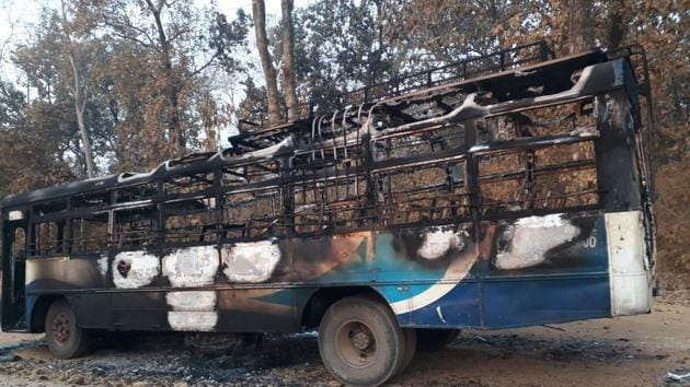 The buses were set on fire at around 9.45 pm on Monday, according to special director general of police, (anti-naxal operations), D M Awasthi.(HT PHOTO)
