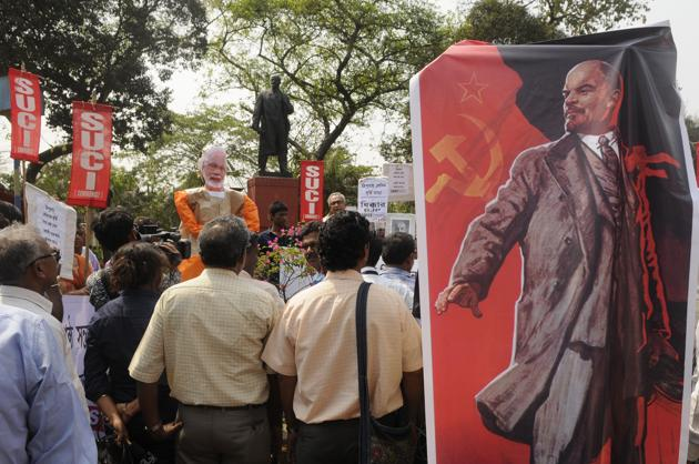 """The Socialist Unity Centre of India (Communist) protest against the demolition of Lenin's statue in Tripura. A BJP leader H Raja on Tuesday allegedly put up a social media post that read: """"Today Lenin's statue, tomorrow Tamil Nadu's EVR Ramaswami statue"""", sparking protests in Tamil Nadu.(Samir Jana/HT Photo)"""