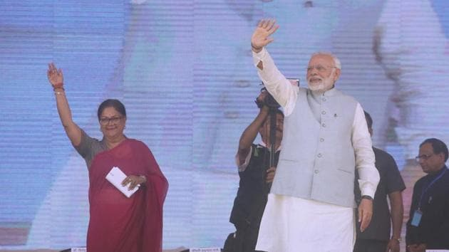 Prime Minister Narendra Modi and chief minister Vasundhara Raje at the Launch of national nutrition mission in Jhunjhunu district of Rajasthan.(Himanshu Vyas/HT Photo)