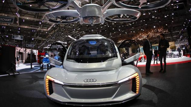 The Audi AG Pop.Up Next self-driving automobile and passenger drone concept vehicle on display at the 88th Geneva International Motor Show in Geneva, Switzerland, on Wednesday.