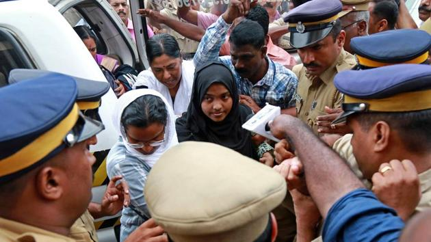 Hadiya, earlier Akhila Ashokan, arrives at the airport in Kochi.(Reuters File Photo)