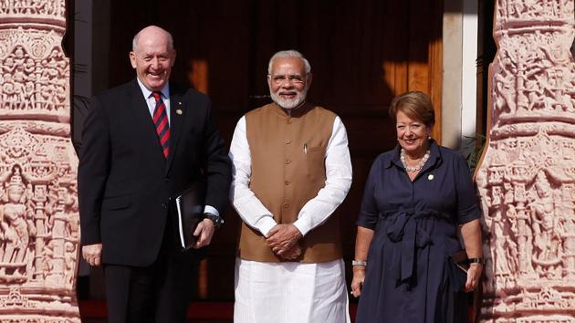 Prime Minister Narendra Modi (C) poses for a picture with Australia's Governor General Peter Cosgrove and his wife Lynne (R) as they arrive to attend the International Solar Alliance Founding Conference in New Delhi.(REUTERS)