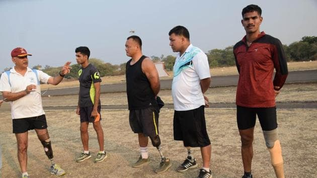 A group of the para-athletes at the Paralympic Sports Node, BEG, share a light moment during training. A total of 26 athletes are training under Lt Col Gaurav Dutta.(HT PHOTO)