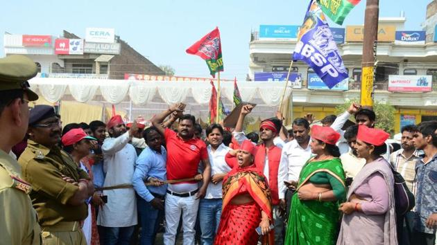 SP, BSP workers celebrate in Allahabad as the Samajwadi Party inches towards victory in a by-election on Wednesday.(Anil Kumar Maurya/HT Photo)