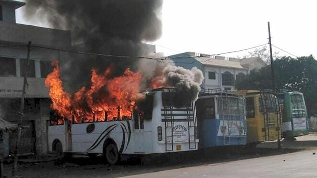 A bus set on fire during clashes after the Tiranga bike rally in Kasganj.(PTI File Photo)