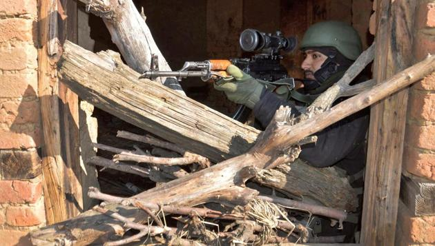 An Army soldier takes position during a gun battle in which three militants were killed, at Kokarnag in Anantnag district of South Kashmir on March 13 2018.(PTI File Photo)