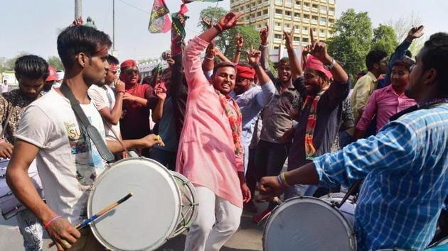 Samajwadi Party supporters celebrate their win against the BJP in Phulpur and Gorakhpur Lok Sabha by-election results, in Allahabad on Wednesday.(PTI)
