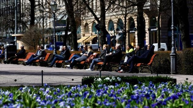 People enjoy a sunnny day at the Esplanade in Helsinki, Finland. The country has topped the UN's happiness rankings(REUTERS File)