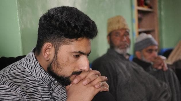Kamran Yousuf, a Kashmiri photojournalist who was released on bail six months after his arrest by the National Investigation Agency, at his house in Tahab village of Pulwama district, South Kashmir, on Friday.(Waseem Andrabi/HT Photo)