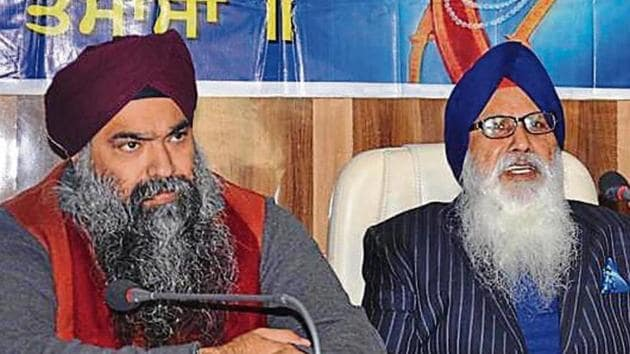 Former chief of Khalsa Diwan Charanjit Singh Chadha (R) with his now-deceased son Inderpreet Singh.(HT File)