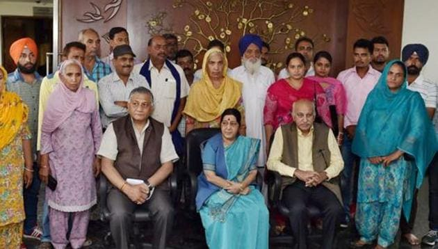 Foreign minister Sushma Swaraj and ministers of state for external affairs MJ Akbar and Gen VK Singh with the family members of the 39 Indian men who went missing in Iraq in 2014.(PTI FILE)