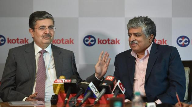 Vice-chairperson and managing director of Kotak Mahindra Bank Uday Kotak speaks as Infosys co-founder & non-executive chairperson Nandan Nilekani looks on, during a press conference in Mumbai on Tuesday.(PTI Photo)