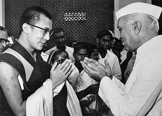 Jawaharlal Nehru greets the Dalai Lama at the airport on September16 1959.(Bettmann Archive/Getty Images)