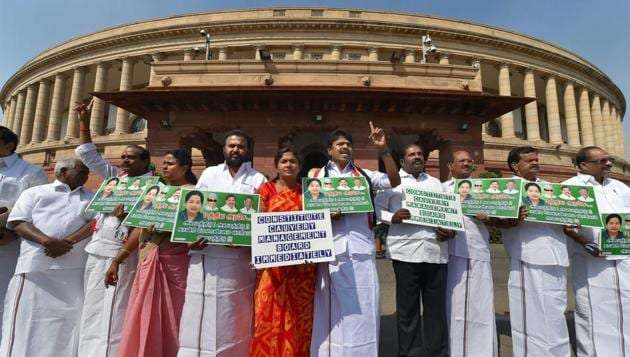 AIADMK leaders raise slogans demanding the constitution of Cauvery Management Board during the budget session, at Parliament House in New Delhi on Friday.(PTI)