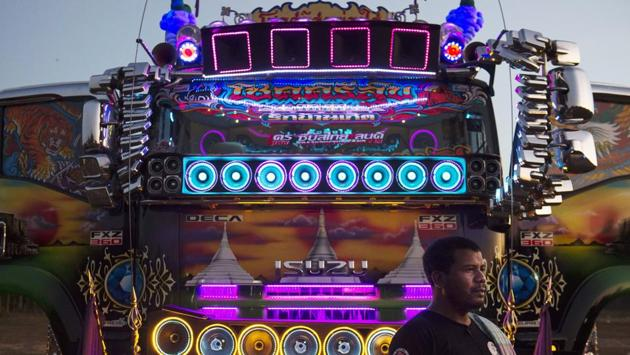 <p>Music pounds from the speakers and LED lights ripple across the customised cabs at a &ldquo;truck party&rdquo; hosted by proud Thai drivers showing off their...