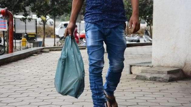 Pune, India - December 5, 2017: A customer seen using plastic bag (For Illustration Purpose only) Pune, India, on Tuesday, December 5, 2017. (Photo by Shankar Narayan/HT PHOTO)