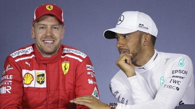 Mercedes driver Lewis Hamilton, right, of Britain, and Ferrari driver Sebastian Vettel of Germany share a light moment during a press conference following qualifying at the Australian Formula One Grand Prix in Melbourne, Saturday (March 24).(AP)