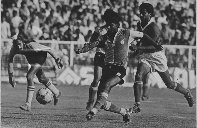 November 10, 1993: East Bengal striker Sanjay Majhi drills in a left-footer beyond Punjab State Electricity Board goalkeeper Balwinder Singh Binda for the winner as defender HP Singh (left) watches helplessly in the Durand cup football final in New Delhi. East Bengal won-1-0 lift the trophy for the 11th time.(HT file photo)