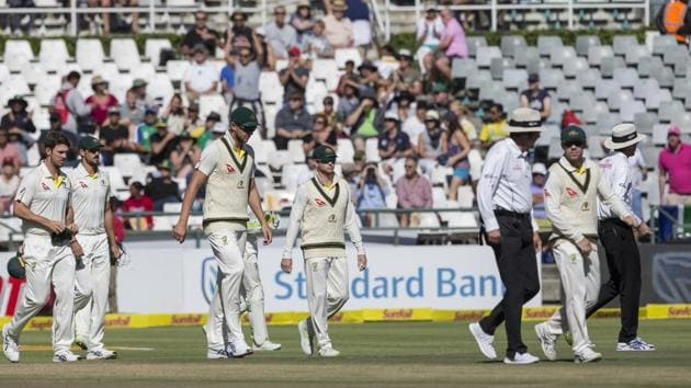 Steven Smith of Australia, center, takes to the field with the team on the fourth day of the third cricket test between South Africa and Australia at Newlands Stadium, in Cape Town, South Africa, Sunday.(AP)