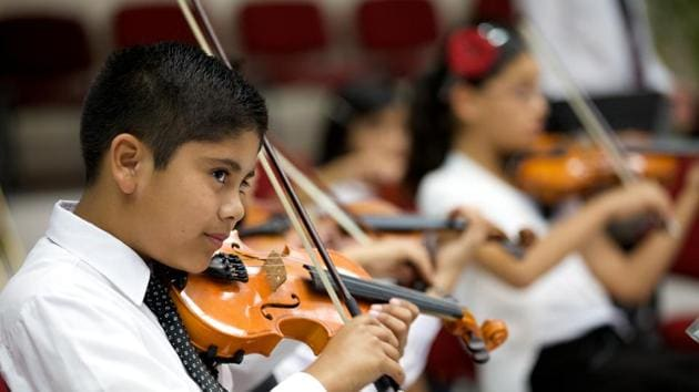 Children who received music lessons showed improved language-based reasoning and the ability to plan, organise and complete tasks, as well as improved academic achievement, say researchers.(Getty Images)