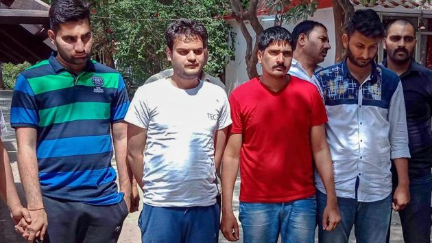 Ajay Kumar, Gaurav, Sonu Singh and Param allegedly involved in online hacking of Staff Selection Commission (SSC) exam arrested in a joint operation by Uttar Pradesh Special Task Force (STF) and the Delhi Police in New Delhi on Wednesday.(PTI Photo)