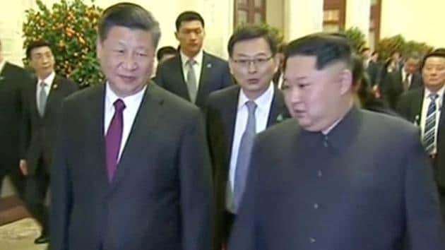 Chinese president Xi Jinping walks with North Korean leader Kim Jong Un, in this still image taken from video released on March 28, 2018.(Reuters)