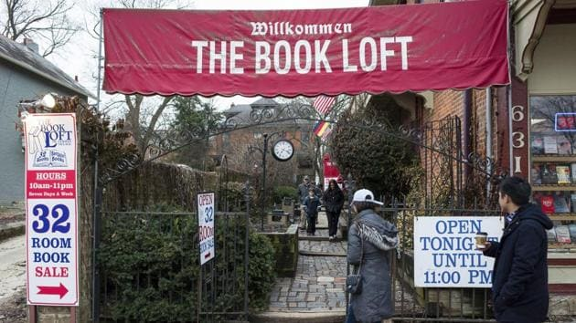 Customers approach the entrance to The Book Loft of German Village in Columbus, Ohio.(AP Photo/Jonathan Elderfield)