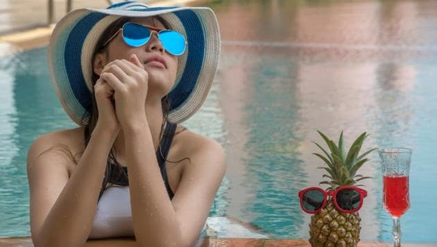 A dip in the pool can beat the summer heat but it can leave a severe tan on the skin for months.(Shutterstock)