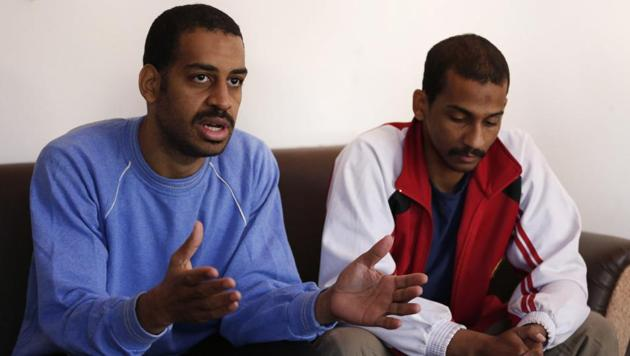 Alexanda Amon Kotey (left) and El Shafee Elsheikh, who were allegedly among four British jihadis who made up a brutal Islamic State cell dubbed 'The Beatles', speak during an interview with The Associated Press at a security center in Kobani, Syria, on March 30, 2018.(AP)