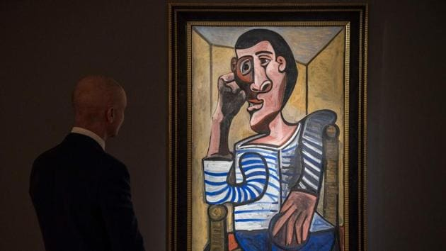Conor Jordan, deputy chairman of impressionist and modern art at Christie's looks to Pablo Picasso's 'Le Marin' during a media preview of Christie's Hong Kong Spring Sales in Hong Kong.(AFP)