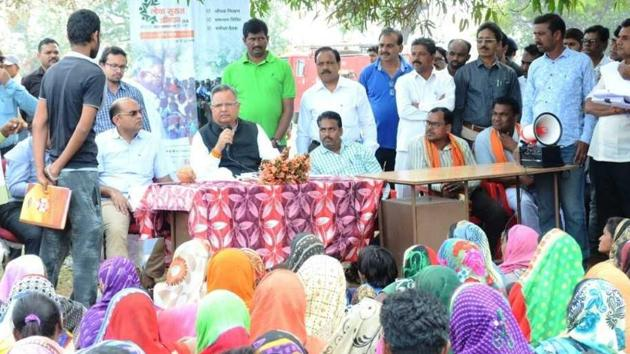 More than 200 tribals of Singari village in Kabirdham district of Chhattisgarh had gathered at the chaupal, some out of curiosity to see chief minister Raman Singh for the first time, and some to air their grievances.(HT Photo)