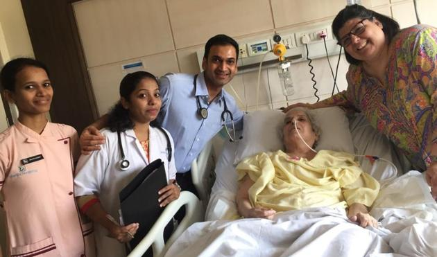 Dr Samrat Shah (in blue) with Dinoo Irani and her daughter Feruza, before Dinoo was discharged from Bhatia hospital on Sunday.(HT PHOTO)