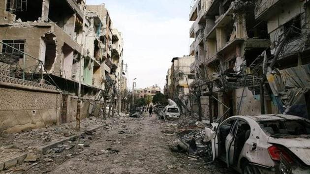 Damaged buildings are seen in the besieged town of Douma, Eastern Ghouta, Damascus, Syria, February 25.(Reuters Photo)