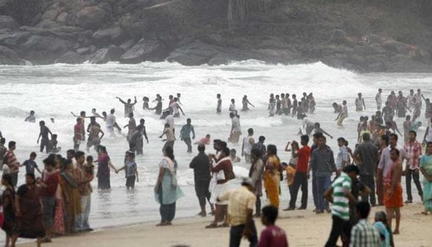 People at Kerala's Kovalam beach, which is considered one of the major tourist attractions in the country. The 33-year-old Latvian tourist, Liga, went missing from the beach on March 14.(AP Photo)