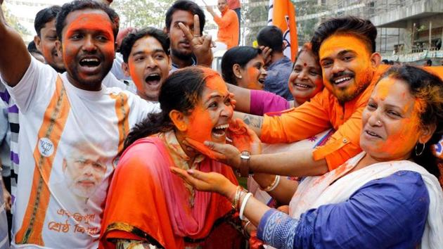 Bharatiya Janata Party supporters celebrate after the party's win in Tripura assembly elections, in Agartala, on March 3.(Reuters File Photo)