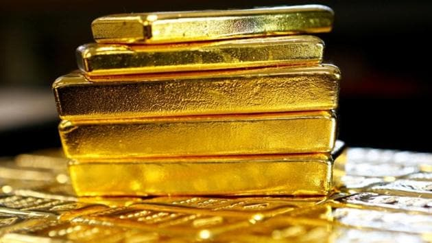 DRI officials recovered 34 gold bars of foreign origin cumulatively weighing 5.6 kg and valued at Rs 1.68 crore from the accused.(Reuters File Photo)