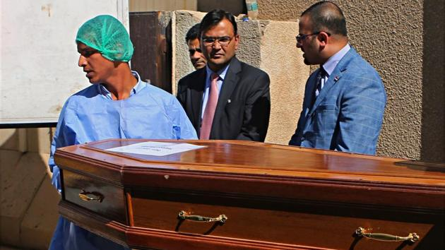 Pradeep Singh Rajpurohit, center, India's Ambassador to Iraq, watches while a casket holding one of Indians abducted by the Islamic State group in 2014, is loaded on a truck to be transported from Baghdad's main morgue to the Baghdad airport, in Iraq on April 1.(AP Photo)