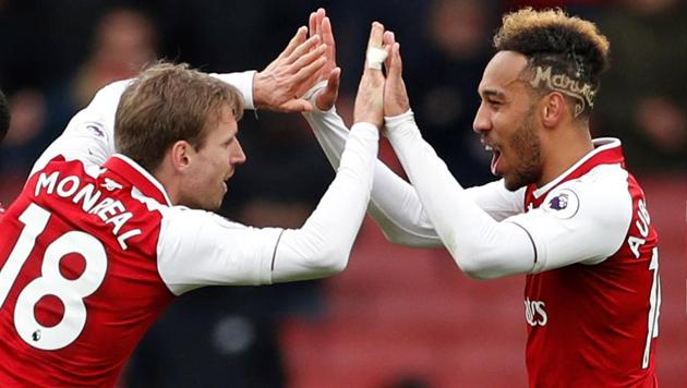 Arsenal's Nacho Monreal and Pierre-Emerick Aubameyang celebrate after the Premier League match vs Stoke City at the Emirates Stadium in London.(Reuters)