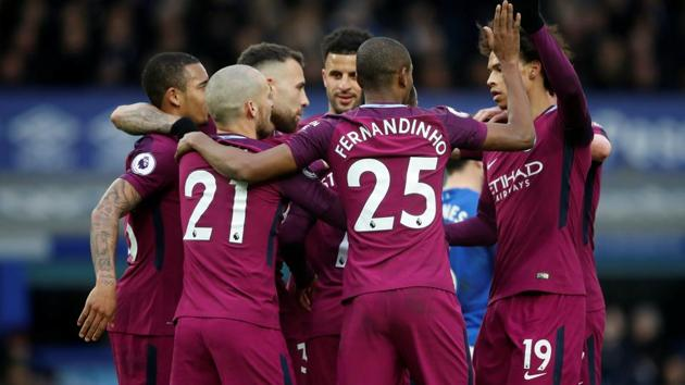 Manchester City warmed up for a season-defining month with a commanding 3-1 win over Everton at Goodison Park to set up a potential Premier League title party against rivals Manchester United.(REUTERS)