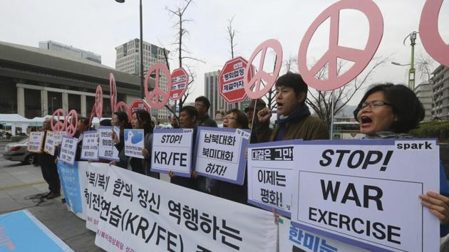 Protesters stage a rally to denounce the annual joint military exercises between South Korea and the United States near the US Embassy in Seoul, South Korea, April 1.(AP Photo)