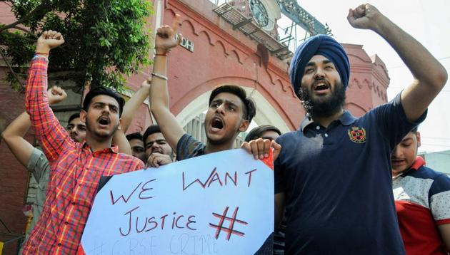 Students stage protest against CBSE's decision to conduct re-examination for economics and maths paper, in Amritsar on Saturday.(PTI Photo)