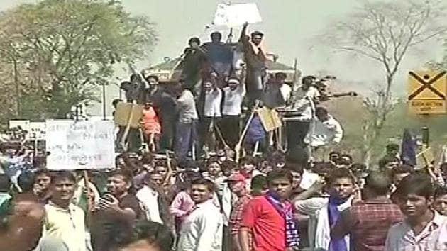 Protestors stop a train in Jaipur.(ANI photo)
