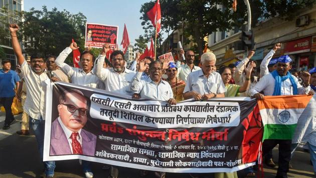 Dalit activist and supporters hold placards and raise slogans during a protest march against the alleged dilution of Scheduled Castes/Scheduled Tribes Act in Mumbai on Monday.(PTI photo)