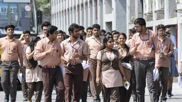 Students of Class 12 coming out after writing CBSE board examinations in Noida on March 26.(Sunil Ghosh / HT file)