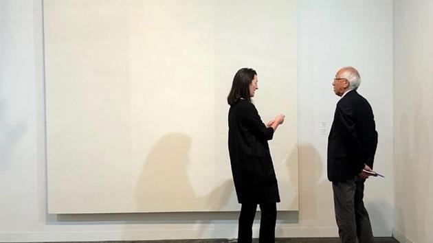 Thomas Yamamoto and the work by Mary Corse.(Katya Kazakina/Bloomberg)