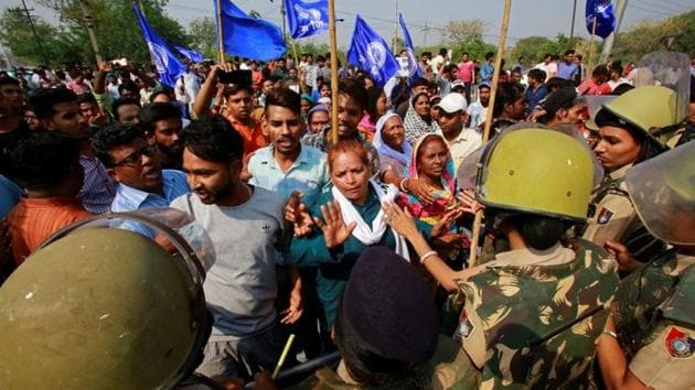 Police try to stop people belonging to the Dalit community as they take part in a protest during a nationwide strike called by Dalit organisations, in Chandigarh, April 2.(Reuters Photo)