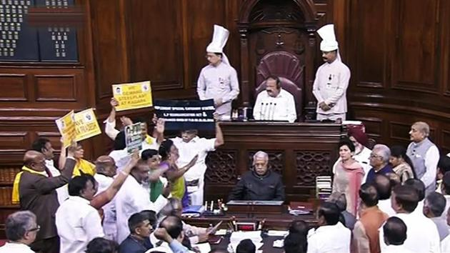Opposition members protest during the ongoing budget session of Parliament in the Rajya Sabha, in New Delhi on Monday.(PTI Photo)