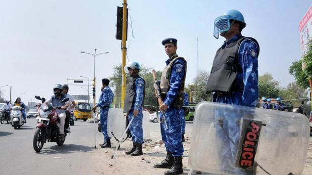 Rapid Action Force personnel stand guard in wake of Bharat Bandh in Amritsar on Sunday.(PTI Photo)