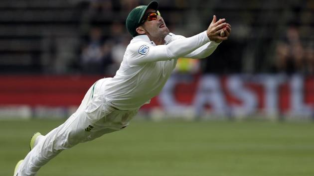 Dean Elgar took a brilliant catch of Tim Paine to dismiss him for 62 and bowl Australia out for 221 in the Johannesburg Test.(AP)